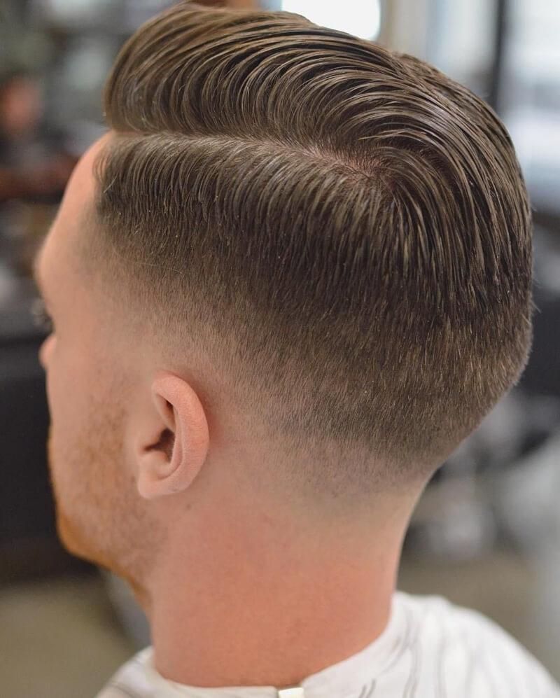 Tóc Side Part cắt kiểu taper với 2 bên được cạo thấp